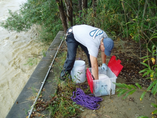 Tommy Liddell taking grab samples at the Santa Clara River Mass Emission Monitoring Site (Nov. 2005)