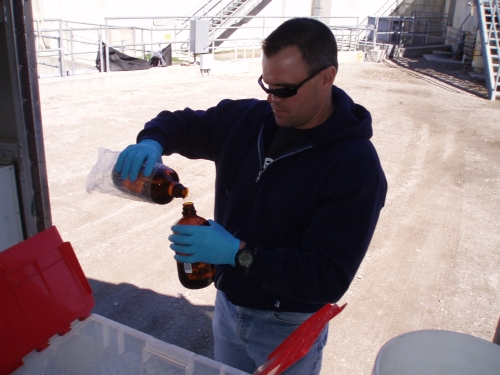 Tommy Liddell pouring a field blank sample at the Santa Clara River Mass Emission Monitoring Site (Feb. 2007)